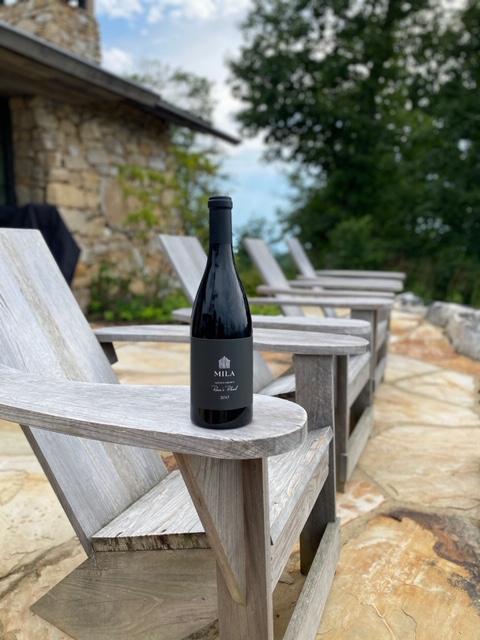 Adirondack chairs with Mila wine