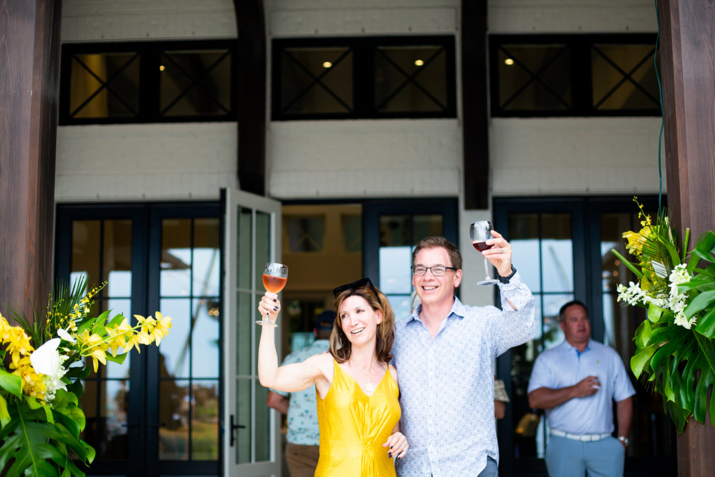 Loretta & Michael at event, holding glasses up