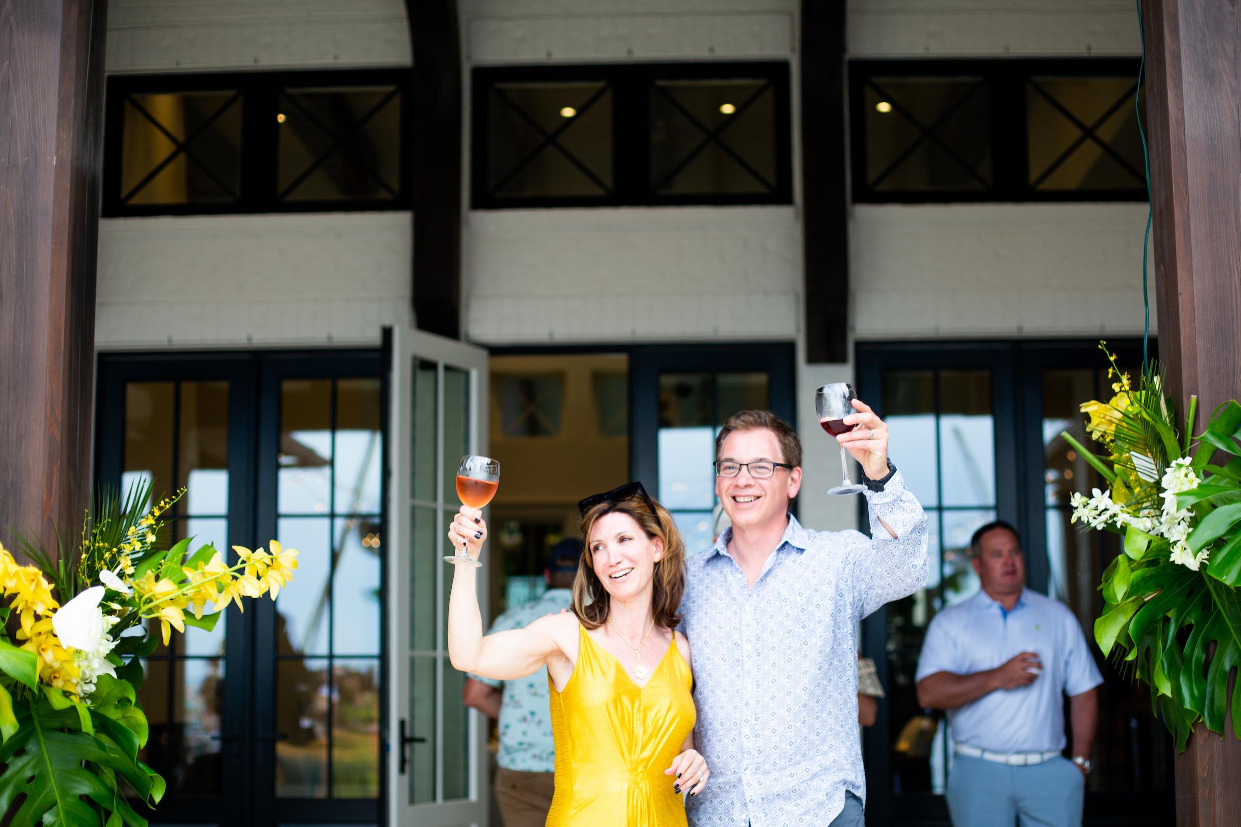 Loretta & Michael at event, holding glasses up
